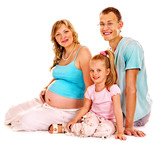 Pregnant woman with family.