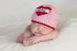 """Newborn Baby Girl Wearing a """"Love Dad"""" Hat"""