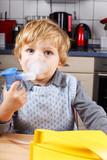 Adorable toddler  boy making inhalation with nebulizer poster