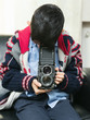 child with classic camera