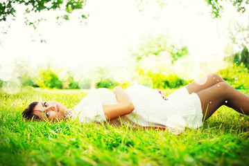 Beautiful Pregnant Woman lies the Park