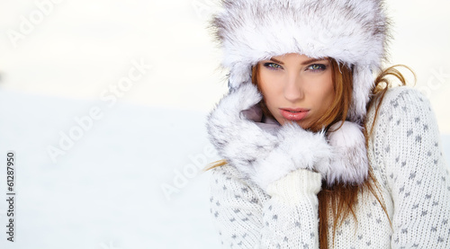 Attractive young woman in wintertime outdoor