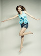 fashion model jumps in studio