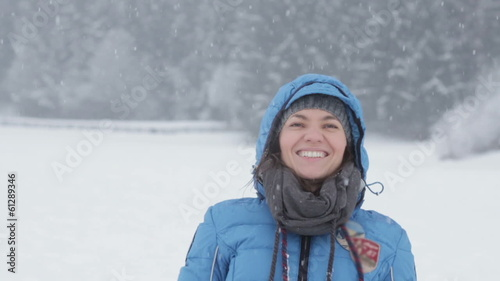 Young woman defending from snowballs, slow motion