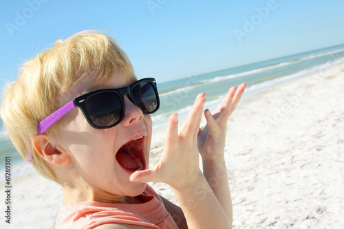 Excited Child on Beach by Ocean