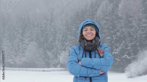 Portrait of a young woman in winter park, slow motion