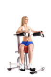 Sporty woman exercising on modern simulator