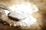 Flour in measuring spoon