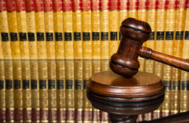 Justice gavel with burred law books in the background