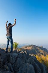 man on rock at mountain