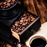 Cup of espresso with coffee beans and Coffee mill with roasted c