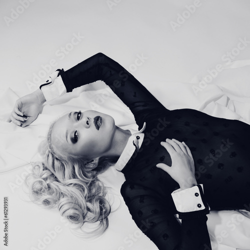 portrait of elegant blond woman in bed