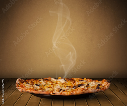 Fresh delicious home cooked pizza with steam