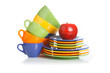 Kitchen utensils, plates and cups on a white background
