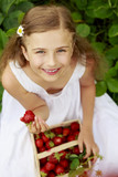 Garden - girl with picked strawberries