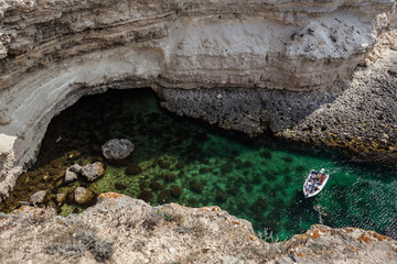 boat in a rocky bay