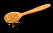 Wooden Spoon with Mustard Seeds on Black Background