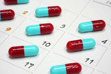 red and blue capsules on calender