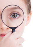 Close-up portrait of  little girl looking through a magnifying g