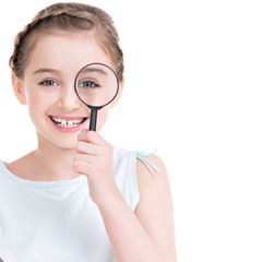 Close-up portrait of  little girl looking through a magnifying
