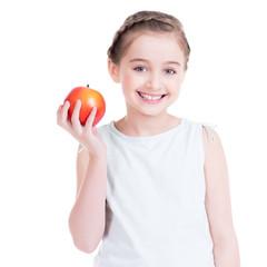 Portrait of cute little girl holding an apple.