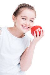 Portrait of cute little girl holding an apple.