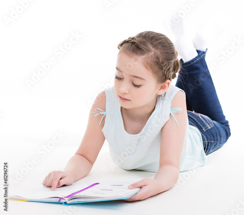 Lovely little girl lies with the book/