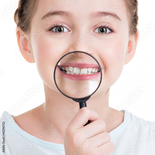 Close-up portrait of little girl showing teeth through a magnify