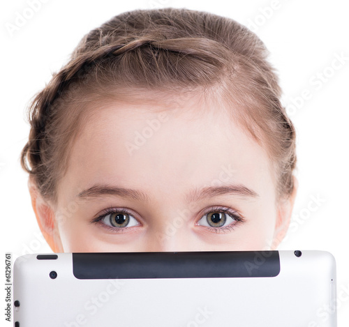 Close-up of little girl sitting with the tablet.