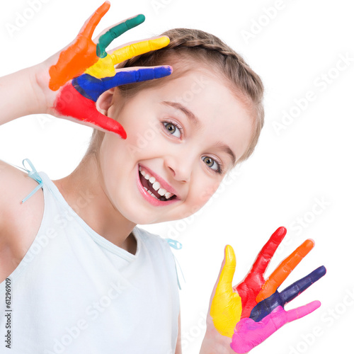 Happy pretty little girl with painted hands.