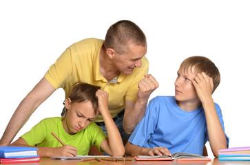 dad helping children with their homework