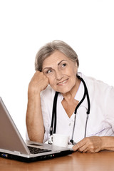 Woman doctor sitting with laptop