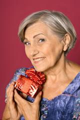Senior woman with gift box