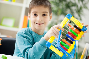 young boy at home working on the abacus