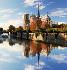 Notre Dame with boat on Seine in Paris, France