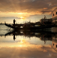 Venice with gondola against beautiful sunset in Italy