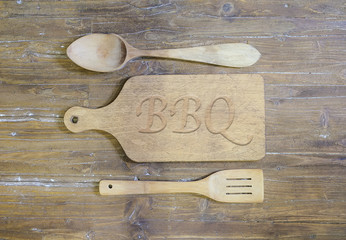 Cutting board with the word, BBQ.