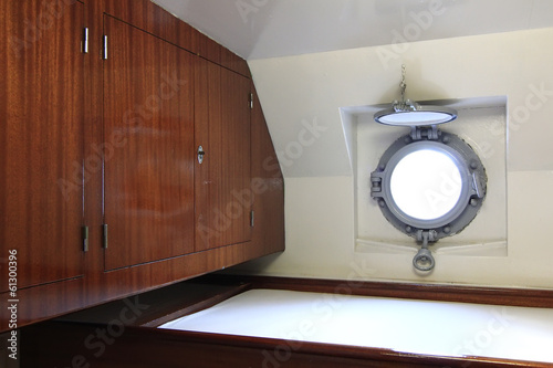 small cabin with porthole on a ship