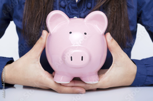 Close-up of a businesswoman holding a piggy bank