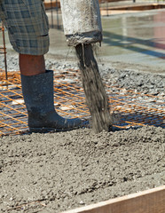 Pouring concrete at a construction site - closeup