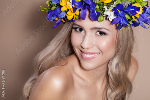 Young woman with a flower arrangement in her hair