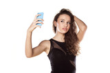 pretty teen girl taking selfies with her smart phone poster