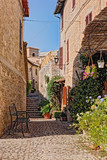 alley with flowers of a small town in Umbria, Italy