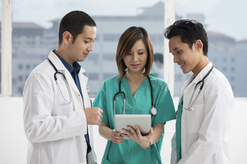 Doctor using a digital tablet PC.