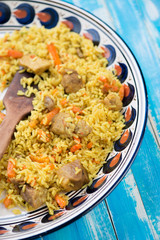 Uzbek national cuisine - pilaf or plov, vertical shot