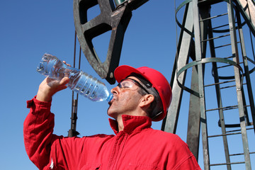Thirsty Oil Industry Worker.