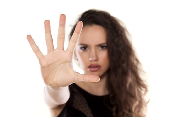angry beautiful girl showing stop hand