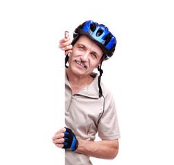 senior man cyclist holding blank board