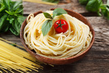 Plate with spaghetti, tomato, sauce and basil