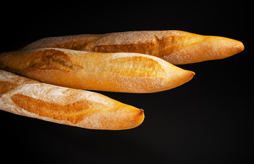 Baguette. Fresh bread isolated on black background
